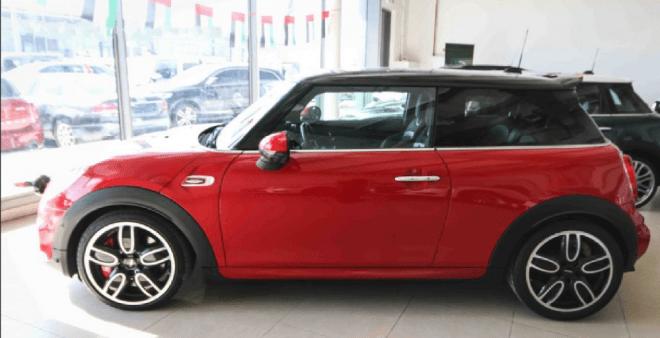 2016 red MINI John Cooper Works for sale in Abu Dhabi.