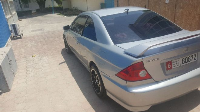 Honda Civic car Coupe american specification (1.7), EX special edition, 2005.