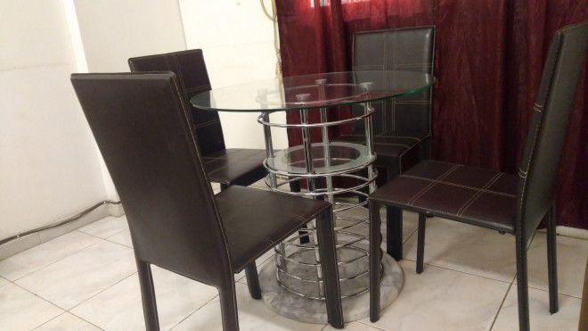 Average Used Dining Table Set With Tempered Glass And Four Leather Chairs