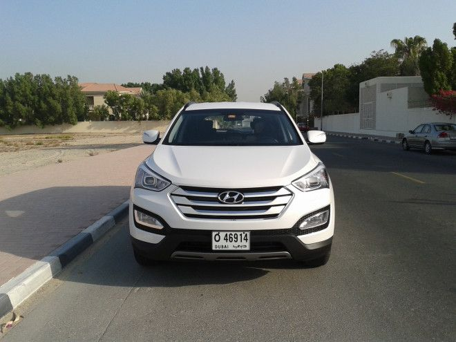 Santa Fe 2014, 2.4L in a very good condition,  all service at Jumaa Al Majid