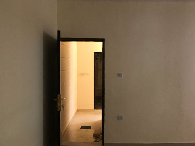 A room and hall in a villa in the Karama area - Abu Dhabi