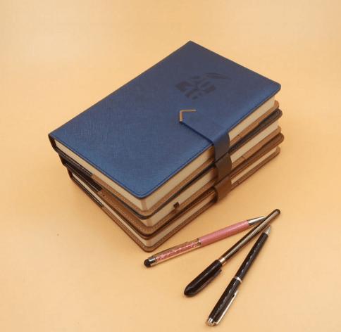 Notepads, notebooks, pens, diaries, journals